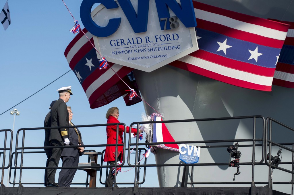 Susan Ford Bales, daughter of former President Gerald R. Ford and sponsor of the aircraft carrier that bears his name, breaks a bottle of champagne on the bow of the aircraft carrier USS Gerald R. Ford (CVN 78) at Newport News Shipbuilding during the christening ceremony for Ford. (U.S. Navy photo 131109-N-WL435-911)
