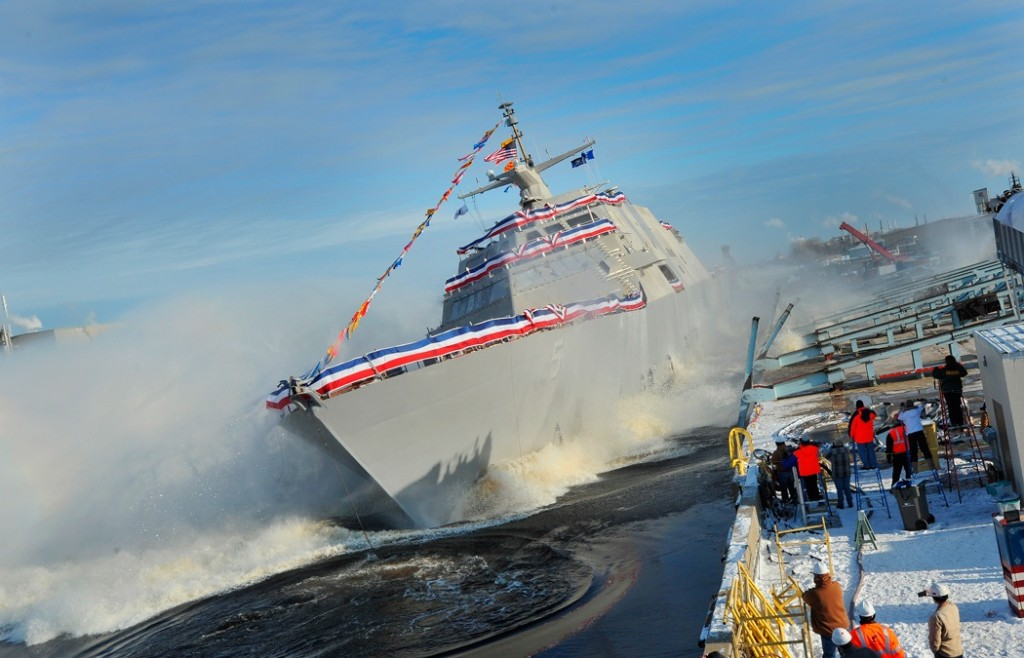 The littoral combat ship Pre-Commissioning Unit (PCU) Milwaukee (LCS 5) slides into the Menominee River during a christening ceremony at the Marinette Marine Corporation shipyard. (U.S. Navy photo 131218-N-EW716-001)