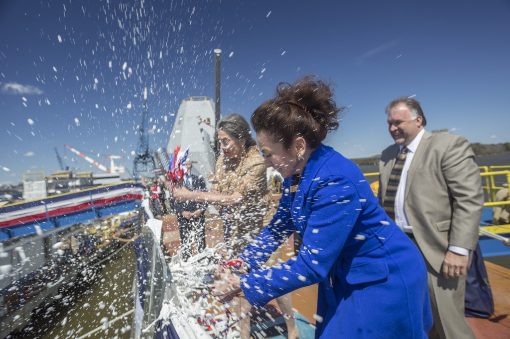 "Mouzetta Zumwalt-Weathers Christens the guided-missile destroyer Pre-Commissioning Unit (PCU) Zumwalt (DDG 1000) during a christening ceremony 12 April 2014 at Bath Iron Works. The ship, the first of three Zumwalt-class destroyers, will provide independent forward presence and deterrence, support special operations forces and operate as part of joint and combined expeditionary forces. The lead ship and class are named in honor of former Chief of Naval Operations Adm. Elmo R. ""Bud"" Zumwalt Jr., who served as chief of naval operations from 1970-1974. (U.S. Navy photo 140412-N-ZZ999-780)"