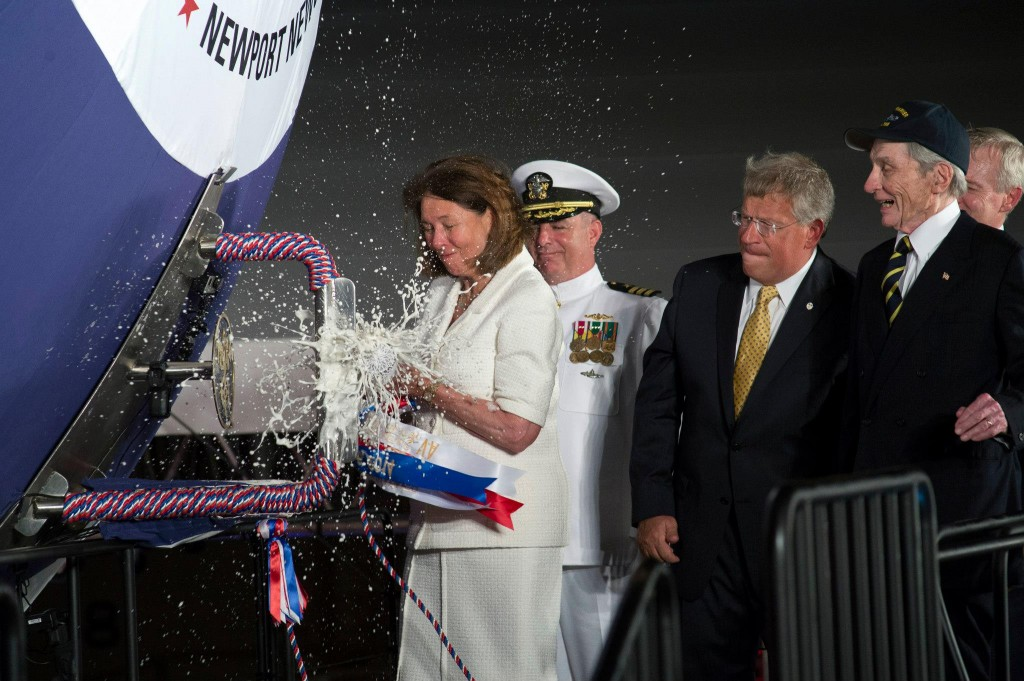 Jeanne Warner christens the Virginia-class attack submarine Pre-Commissioning Unit (PCU) John Warner (SSN 785). (U.S. Navy photo courtesy of Huntington Ingalls Industries by John Whalen/Released)
