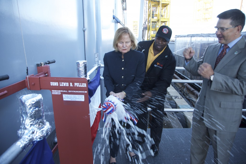 Mrs. Martha Puller Downs, daughter of General Puller, christens USNS Lewis B. Puller.
