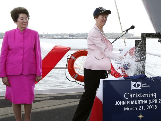 Joyce Murtha, widow of the late Democratic U.S. Rep. John P. Murtha of Pennsylvania, left, braces for the spray of sparkling wine as her daughter Donna S. Murtha christens an amphibious transport dock, the John P. Murtha (LPD 26) named after the longtime lawmaker at Ingalls Shipbuilding, Saturday, March 21, 2015, in Pascagoula, Miss. (Photo: Rogelio V. Solis/AP)