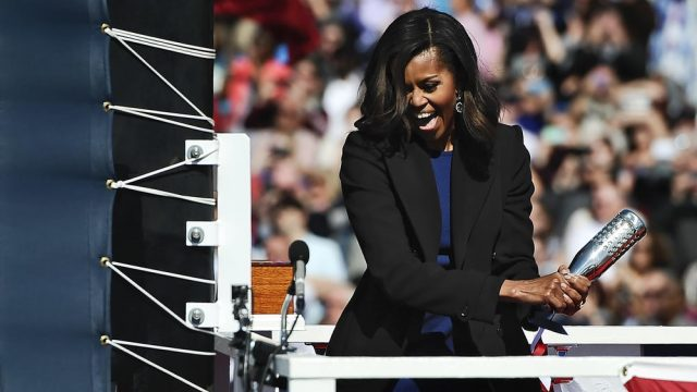 First lady Michelle Obama christens the USS Illinois with a bottle of sparkling wine Oct. 10, 2015, in Groton, Conn. (Jessica Hill / AP)