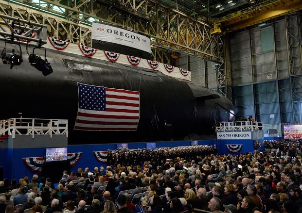 The U.S. Navy's newest attack submarine, the future USS Oregon, is christened in a ceremony at Electric Boat in Groton, Conn., on Saturday, Oct. 5, 2019. Politicians, shipyard leaders and Navy officials gathered for the ceremony at the General Dynamics Electric Boat shipyard, where they spoke about the importance of Virginia-class submarines and praised the skills of the thousands of shipyard workers in Connecticut, Rhode Island and Virginia who built the Oregon. (DANA JENSEN/THE DAY/AP)